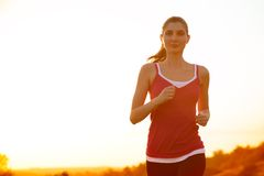 Young Beautiful Woman Running on the Mountain Trail in the Morning Royalty Free Stock Images