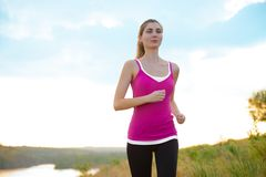 Young Beautiful Woman Running on the Mountain Trail in the Morning Stock Photos