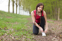 Young beautiful woman running on a trail Royalty Free Stock Photo