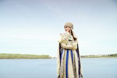 Young beautiful woman in Russian costume Stock Image
