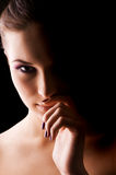 Young beautiful woman's dramatic light portrait Stock Photos