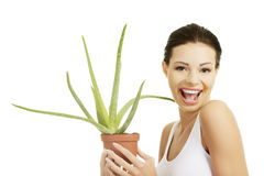 Young beautiful woman's face and aloe vera. Royalty Free Stock Photos