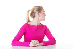 Young beautiful woman's sitting, profile. Royalty Free Stock Photo