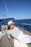Young beautiful woman on sailing boat Stock Photography