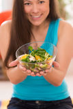 Young beautiful woman with salad. Young beautiful asian woman with bowl of green healthy salad at home Stock Photos