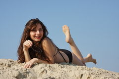Young beautiful woman  on sand Stock Photos
