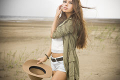 Young beautiful woman on a sandy beach Stock Photos