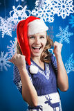 Young beautiful woman in Santa hat is looking at camera smiling. Stock Image