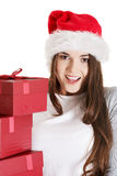 Young beautiful woman in santa hat with presents. Stock Photography