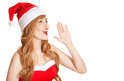 Young Beautiful Woman In Santa Hat Screaming Stock Photo