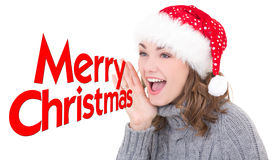 Young beautiful woman in santa hat shouting Royalty Free Stock Photography
