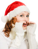 Young beautiful woman in a Santa hat whispers Royalty Free Stock Image