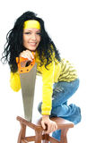 Young beautiful woman with a saw Royalty Free Stock Photo