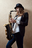 Young beautiful woman with saxophone Stock Photo