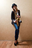 Young beautiful woman with saxophone Stock Photography