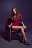 Young beautiful woman in scarlet  kombidress.  Fashion model sho Stock Photos