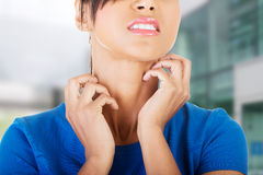 Young beautiful woman scratching her self. Stock Photography