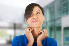 Young beautiful woman scratching her self. Stock Photo