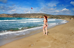 The young beautiful woman on seacoast.Greece. Royalty Free Stock Images
