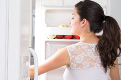 Young beautiful woman searching for food in the Royalty Free Stock Photo