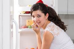 Young beautiful woman searching for food in the Royalty Free Stock Photos