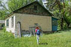 Young beautiful woman searching for way out from the abandoned children summer camp. At Ukraine Royalty Free Stock Photo