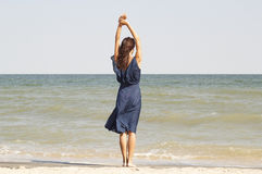 Young beautiful woman at seaside in blue dress Royalty Free Stock Photo