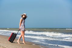 Young beautiful woman during seaside vacation. stock photography