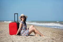 Young beautiful woman during seaside vacation. stock photos