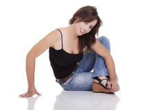 Young and beautiful woman  seated on floor Royalty Free Stock Image