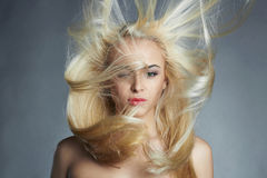 Young beautiful woman. Sexy blond girl. Beautiful healthy hair Royalty Free Stock Photos