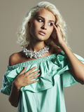 Young beautiful woman. Sexy Blond girl.dress and accessories. Curly hairstyle Royalty Free Stock Photo