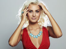 Young beautiful woman.Sexy Blond girl.plastic surgery breast. Red dress Stock Photos