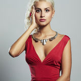 Young beautiful woman.Sexy body Blond girl.red dress Royalty Free Stock Photography