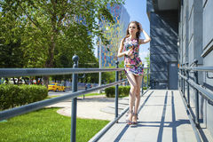 Young beautiful woman in dress on the summer street royalty free stock photo