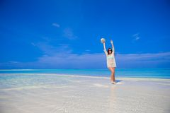 Young beautiful woman at shallow tropical water Stock Photo