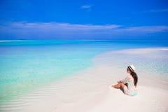 Young beautiful woman at shallow tropical water Royalty Free Stock Photos