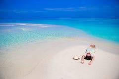 Young beautiful woman at shallow tropical water Stock Photos