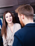 Young beautiful woman and shop assistant Stock Photography