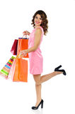 Young beautiful woman with shopping bags isolated on white Royalty Free Stock Photos