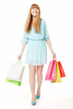 Young, beautiful woman with shopping bags on white background Royalty Free Stock Photo
