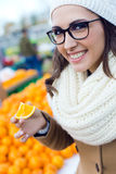 Young beautiful woman shopping fruit in a market. Royalty Free Stock Image