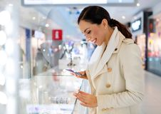 Woman in shopping mall. Young beautiful woman shopping in mall Royalty Free Stock Photo