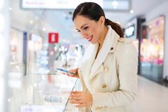 Woman in shopping mall. Young beautiful woman shopping in mall Royalty Free Stock Images