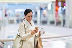 Woman in shopping mall. Young beautiful woman shopping in mall Stock Photography