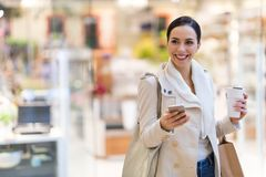 Woman in shopping mall. Young beautiful woman shopping in mall Royalty Free Stock Photos