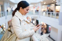 Woman in shopping mall. Young beautiful woman shopping in mall Stock Image
