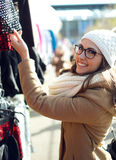 Young beautiful woman shopping in a market. Stock Photos