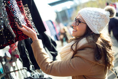 Young beautiful woman shopping in a market. Royalty Free Stock Photos