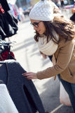 Young beautiful woman shopping in a market. Royalty Free Stock Image